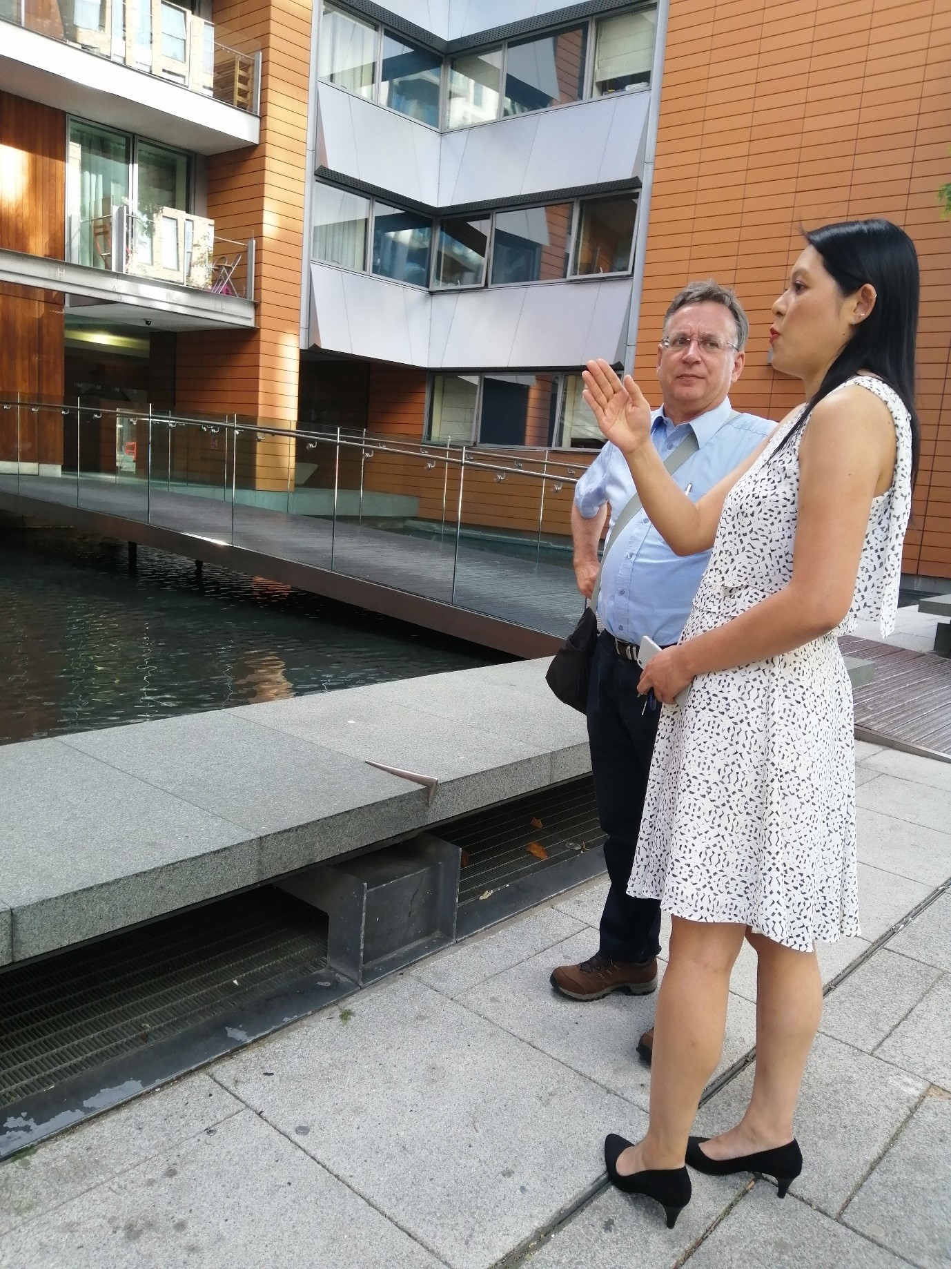 Mr Dismore with leaseholder Ju-Li Leong, viewing the ACM cladding on her block. She faces bills in excess of £40,000 from the managing agents, despite Government assurances that leaseholders should not face such huge bills.